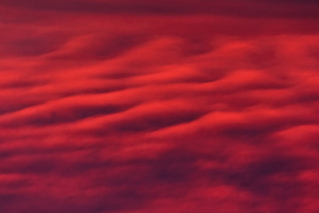 Beautiful red clouds, waves in the sky