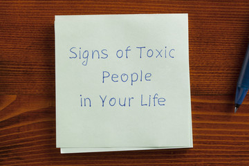 Signs of Toxic People in Your Life written on a note
