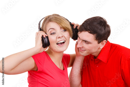 """Couple two friends with headphones listening to music ..."