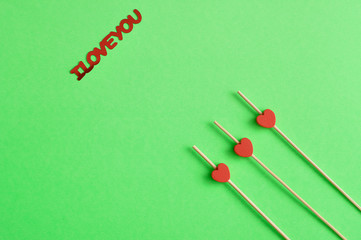 Valentine's Day. Three red hearts on sticks