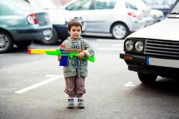 Boy holding toy rifle