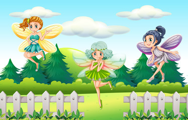 Three fairies flying in garden