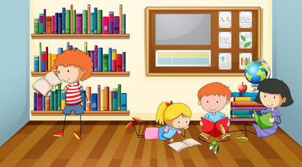 Children reading books in classroom