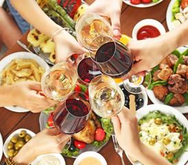 Aluminium Prints Picnic Friends cheering with glasses of wine in restaurant