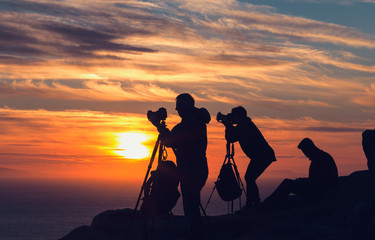 A Group of Photographers on the Clifftop Taking Sunset Pictures