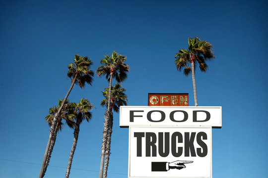 food truck sign with palm trees