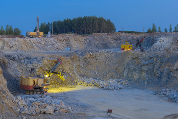 stone crusher in a quarry. mining industry, night view