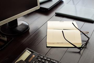 Open notebook on office desktop close up