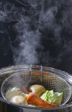 cooking vegetables steamed in a pot