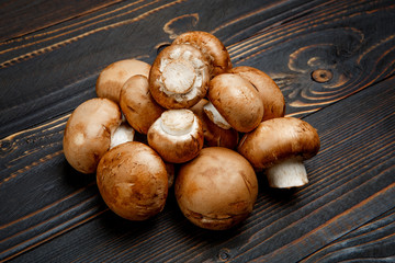champignon mushroom on wooden background