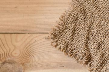 sack burlap texture on wood background