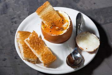 boiled egg and crispy bread, top view