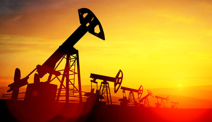 3d illustration of oil pump jacks on sunset background