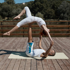 Healthy couple in yoga position
