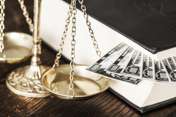 Justice scale and money on the desk