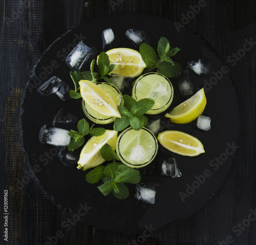 limoncello iralian traditional liqueur with lemons on the vintage table stockfotos und. Black Bedroom Furniture Sets. Home Design Ideas