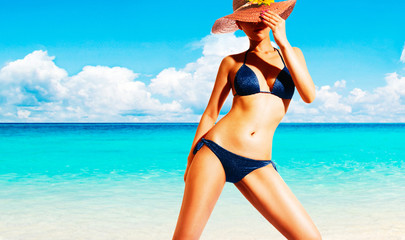 Beautiful body woman with bikini standing on the beach. Summer vacation diet image.