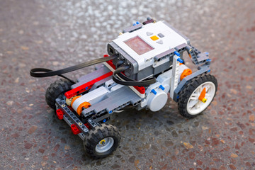 Toy robot from plastic blocks car