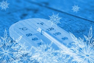 cool thermometer, ice frost snowflake temperature freeze day concept.