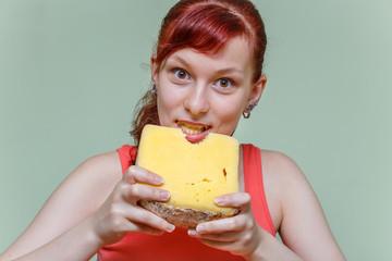 girl bites cheddar cheese