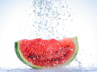 Red watermelon slice with splash of water