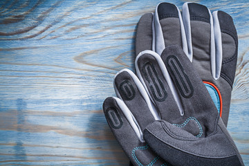 Pair of safety gloves on wooden board gardening concept