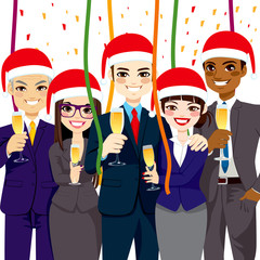 Happy small business people group wearing Santa hat at corporate Christmas party