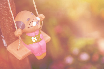old man happy swing doll in the park vintage color tone, Happy Life After Retirement  concept.
