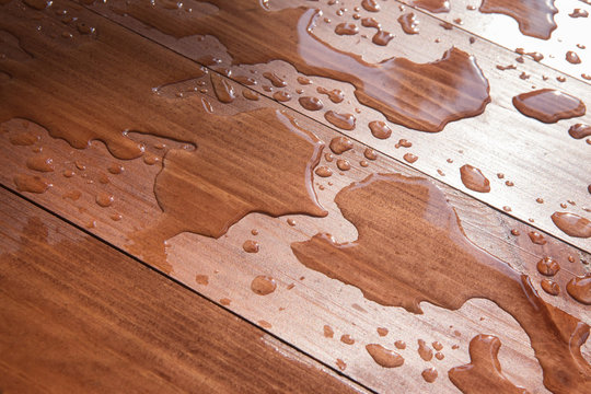 water drops on wooden board