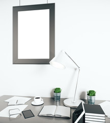 Bright workplace with empty frame