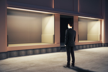 Businessman looking at storefront