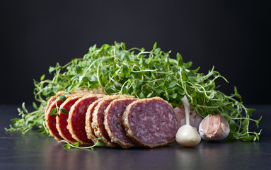 sliced salami with thyme and garlic