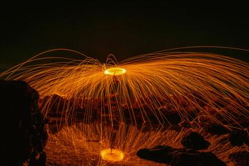 Burning steel wool on stone near the beach.