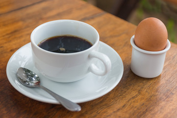 Black coffee with poached egg