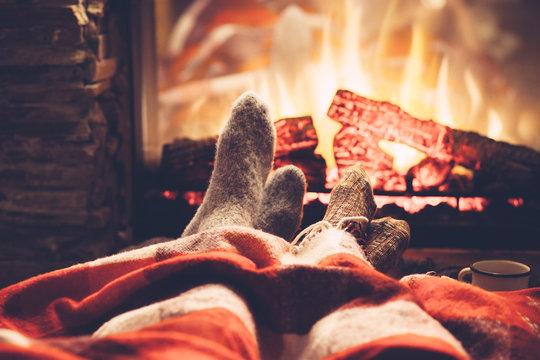 Feet in socks by the fire