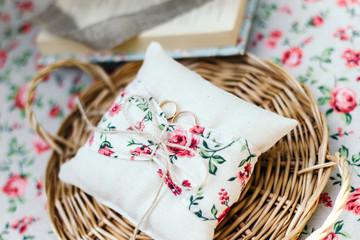 Wedding rings on a cushion handmade.