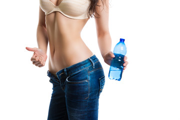 beautiful perfect female body. girl holding a bottle of clean drinking water. Diet. Body care.