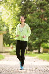 Young woman jogging. She is happy.