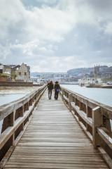 People walking on the pier in Fecamp (Normandy)