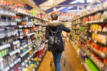 women shopping supermarket shop from shell in blurry for background