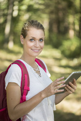 woman backpacker using tablet