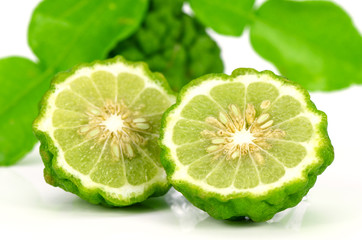 Fresh Fruits and Green Leaves of Kiffir lime or Leech lime on White background.