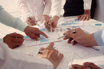 Group of business peopleworking with papers together