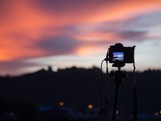 Close up camera the night view of city, background Landscape out of focus