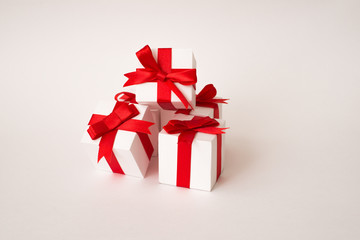 White gift box with red ribbon bow. clipping path