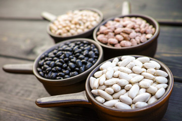 Beans variety/ different types of beans on black wooden background