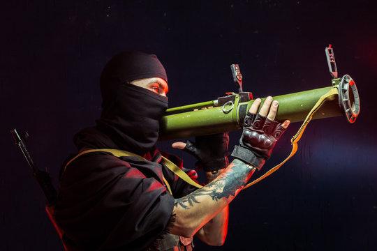 Man aiming through bazooka gun