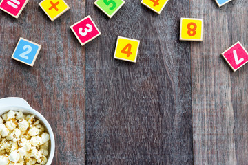 Wooden Toy Plate With Numbers And Popcorn.