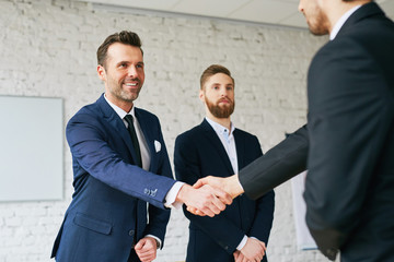 Businessmen shaking hands after successful negotiation