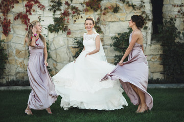 funny bridesmaids spends wonderful  time with  happy bride